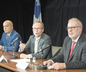 Le ministre de la Sécurité publique, Martin Coiteux, était entouré lundi de ses collègues Robert Poëti et Pierre Arcand du Parti libéral du Québec pour annoncer des mesures à la suite des révélations du député indépendant Guy Ouellette et d'Annie Trudel.