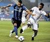Saphir Taïder, de l'Impact et Cristian Higuita, du Orlando City SC se sont disputé le contrôle du ballon sur cette séquence.