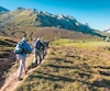 Picos, Spain - Group of hikers climb mountain foothills