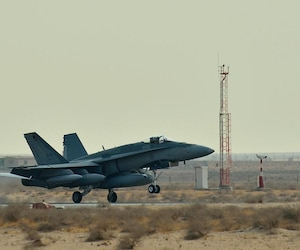 A Canadian Armed Forces CF-18 Fighter jet arrives at the Canadian Air Task Force Flight Operations Area in Kuwait