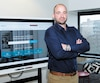 Guillaume Eckerl, cofondateur de HelpMee, une plateforme de services d'urgence en plomberie et électricité dans ses bureaux à Montréal.