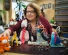 Me Anne-France Goldwater, devant quelques-unes des figurines de son imposante collection, qui orne son bureau.