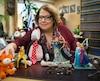 Me Anne-France Goldwater, devant quelques-unes des figurines de son imposante collection, qui orne son bureau.