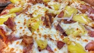 Un rassemblement d'amateurs de pizza hawaïenne