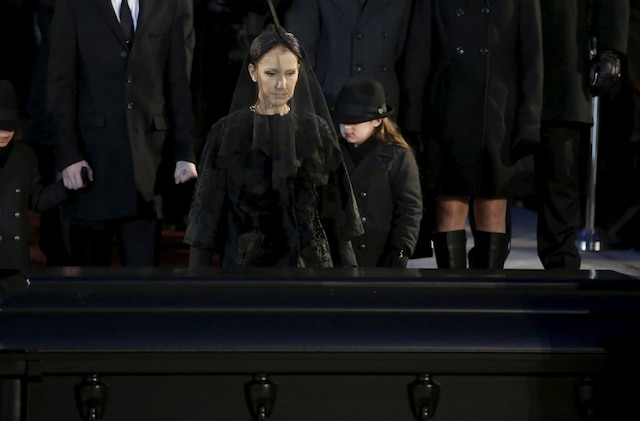 Singer Celine Dion walks up to the casket of her husband Rene Angelil following his funeral at Notre Dame Basilica in Montreal January 22, 2016. REUTERS/Christinne Muschi