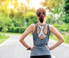 Bloc course sport Back view of young fitness woman running on the road in the morning, People and sport concept
