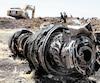 Des débris de l'avion qui s'est écrasé dimanche près de Bishoftu, une ville à 60km d'Addis-Abeba, en Éthiopie, étaient toujours visibles lundi.