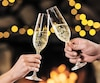 Toasting and celebration champagne glasses on bokeh garlands background. Vertical