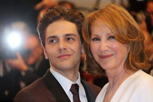 Canadian director Xavier Dolan (L) and French actress Nathalie Baye pose as they leave on May 19, 2016 following the screening of the film