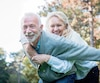 Happy elderly couple smiling outdoors in nature