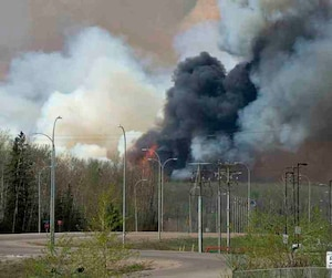 Wildfires continue to burn near Fort McMurray neighborhoods in Fort McMurray Alberta
