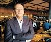 Le PDG du Groupe Sportscene, Jean Bédard, a hâte d'avoir ses comptoirs de plats à emporter. Il s'est exprimé en marge de l'assemblée annuelle de la société, en banlieue de Montréal, hier.