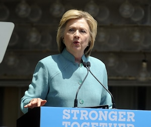 Hillary Clinton speaks at the podium at Boardwalk Hall Arena