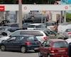 Cars queue to get gas at a petrol station in Saint-Sebastien-sur-Loire