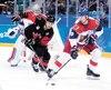 Hockey Canada a demandé à l'annonceur maison de prononcer le nom de Rene Bourque avec une consonance anglophone.