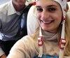 Gabriella Papadakis en compagnie de Rock Therrien, le président de Neuroperforma, lors d'une séance d'entraînement à la clinique de Brossard en 2015.