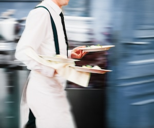 Waiter Serving In Motion On Duty in Restaurant Long Exposure