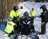 Cette photo montre en les policiers et les agents de surveillance de la Fédération qui ont précédé à une opération de vérification des motoneigistes lors d'un barrage qui se déroulait en fin de semaine dernière, sur la Trans-Québec 5, dans le secteur de Rimouski.