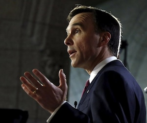 Canada's Finance Minister Bill Morneau speaks to a reporter after delivering the budget on Parliament Hill in Ottawa