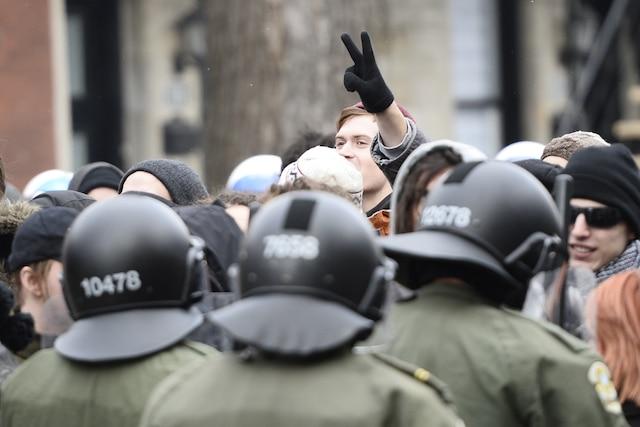 18e manifestation organisée par le Collectif opposé à la brutalité policière (COBP), dans les rues de Montréal, ce samedi 15 mars 2014. JOËL LEMAY/AGENCE QMI