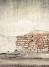 Muret endommagé par des déneigeurs
