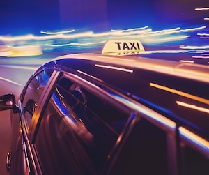 Taxi taking a left turn at night