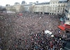 A general view shows an ambulance surrounded by hundreds of thousands of people gathering on the Place de la Republique to attend the solidarity march in the streets of Paris