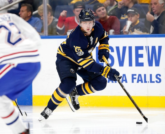 BUFFALO, NY - OCTOBER 5: Jack Eichel #15 of the Buffalo Sabres skates with the puck around Karl Alzner #22 of the Montreal Canadiens during the second period at the KeyBank Center on October 5, 2017 in Buffalo, New York.   Kevin Hoffman/Getty Images/AFP == FOR NEWSPAPERS, INTERNET, TELCOS & TELEVISION USE ONLY ==