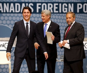 Liberal leader Trudeau, Conservative leader and PM Harper New Democratic Party (NDP) leader Mulcair, walk off stage at the end of the Munk leaders' debate on Canada's foreign policy in Toronto