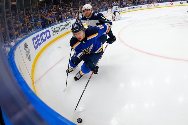 ST. LOUIS, MO - APRIL 20: Robert Thomas #18 of the St. Louis Blues beats Dmitry Kulikov #5 of the Winnipeg Jets to the puck in Game Six of the Western Conference First Round during the 2019 NHL Stanley Cup Playoffs at the Enterprise Center on April 20, 2019 in St. Louis, Missouri.   Dilip Vishwanat/Getty Images/AFP == FOR NEWSPAPERS, INTERNET, TELCOS & TELEVISION USE ONLY ==