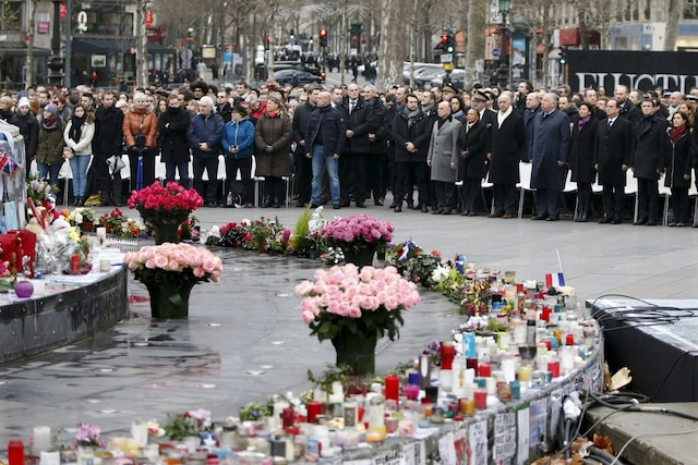 People attend a ceremony at Place de la Republique square to pay tribute to the victims of last year's shooting at the French satirical newspaper Charlie Hebdo, in Paris, France, January 10, 2016. France this week commemorates the victims of last year's Islamist militant attacks on satirical weekly Charlie Hebdo and a Jewish supermarket with eulogies, memorial plaques and another cartoon lampooning religion.  REUTERS/Charles Platiau