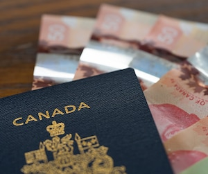 Canadian Passport with Canadian Dollars for business and holiday trip