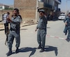 Afghan policemen keep watch near the site of a suicide bomb attack in Kabul