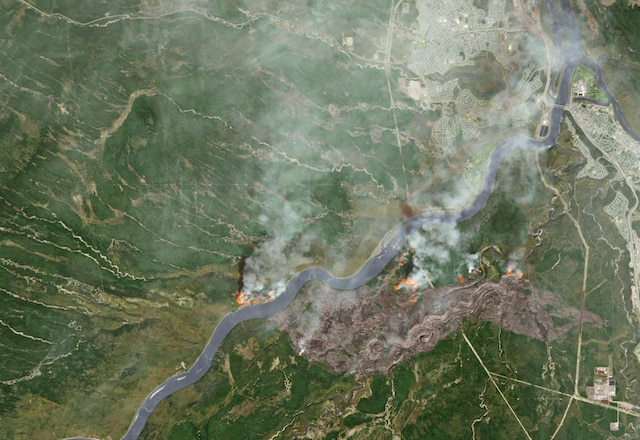 Smoke from wildfires near Fort McMurray, Alberta, Canada are shown in this satellite photo from NASA taken May 3, 2016.  Courtesy NASA/Handout via REUTERS     ATTENTION EDITORS - THIS IMAGE WAS PROVIDED BY A THIRD PARTY. EDITORIAL USE ONLY