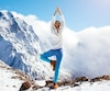 Yoga on mountain in winter