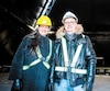 Martin Ouellet et Hélène Demers, cofondateurs de l'entreprise devant la pyramide en construction de Guy Laliberté au Quai de l'Horloge du Vieux-Port de Montréal.