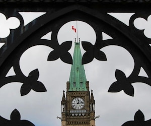 The Canadian flag is seen half mast on the Peace Tower
