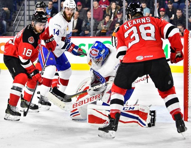 Une arrêt de Charlie Lindgren (35) du Rocket  devant Blake Speers (18) des Devils  et Bracken Kearns (38) des Devils  lors de la deuxième période du match de hockey de l'AHL entre les Devils de Binghamton et le Rocket de Laval à la Place Bell de Laval le mercredi 6 décembre 2017. MARTIN CHEVALIER / LE JOURNAL DE MONTRÉAL