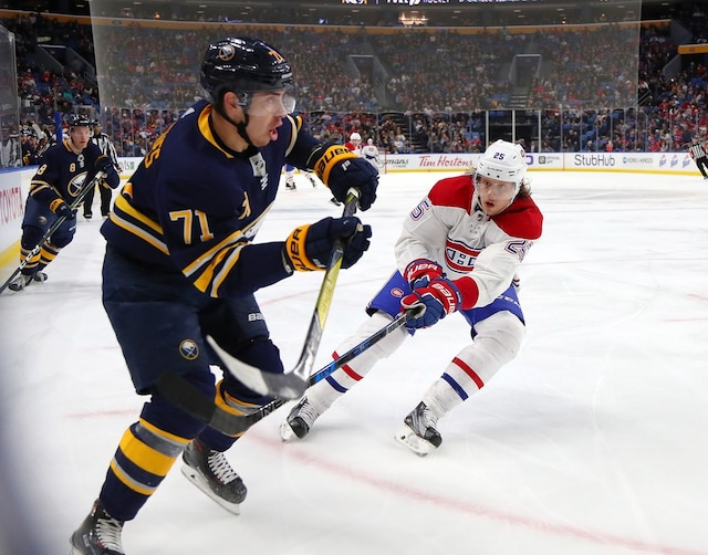 BUFFALO, NY - MARCH 23: Evan Rodrigues #71 of the Buffalo Sabres defends as Jacob de la Rose #25 of the Montreal Canadiens forechecks during the third period at KeyBank Center on March 23, 2018 in Buffalo, New York.   Kevin Hoffman/Getty Images/AFP == FOR NEWSPAPERS, INTERNET, TELCOS & TELEVISION USE ONLY ==