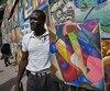 Haiti cinq ans après le tremblement de terre, Louis Saurel, artiste peintre et vendeur de toiles, en face de l'hotel Kinam a Petionville.