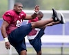Michael Sam stretches during rookie training camp in Sherbrooke, Quebec