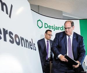 Le président et chef de la direction du Mouvement Desjardins Guy Cormier, et le premier vice-président exécutif et chef de l'exploitation Denis Berthiaume, à l'issue d'un point de presse au sujet de la brèche de sécurité, hier, dans la métropole québécoise.