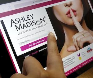 Homepage of Ashley Madison website displayed on iPad, in photo illustration taken in Ottawa