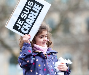 Thousands attend a solidarity Je Suis Charlie rally in London's Trafalgar Square.