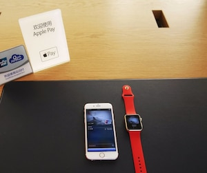 Apple iPhone and Apple Watch are arranged to be photographed after they were used to demonstrate to the Apple Pay service in Beijing