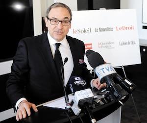 Le grand patron de Capitales Médias, Martin Cauchon, lors de l'annonce à Québec de l'achat dessix quotidiens régionaux de Gesca, en mars 2015.