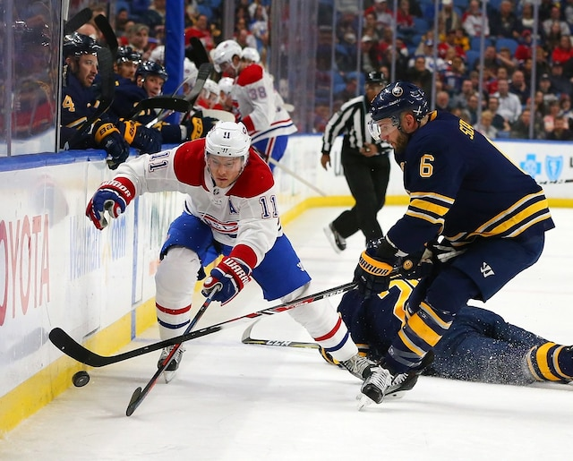 BUFFALO, NY - MARCH 23: Brendan Gallagher #11 of the Montreal Canadiens and Marco Scandella #6 of the Buffalo Sabres go after a loose puck during the first period at KeyBank Center on March 23, 2018 in Buffalo, New York.   Kevin Hoffman/Getty Images/AFP == FOR NEWSPAPERS, INTERNET, TELCOS & TELEVISION USE ONLY ==