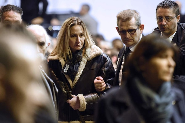 (FILES) This file photo taken on January 16, 2015 shows Ingrid Brinsolaro, the widow of Franck Brinsolaro, the police officer charged with protecting late Charlie Hebdo editor Stephane Charbonnier (aka Charb), attending the funeral ceremony of French cartoonist and Charlie Hebdo editor