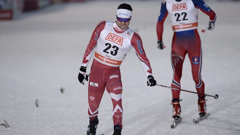 Alex Harvey of Canada crosses the finish-line to place second in the men's free Cross Country 10km competiton at the FIS World Cup Ruka Nordic 2015 event in Kuusamo