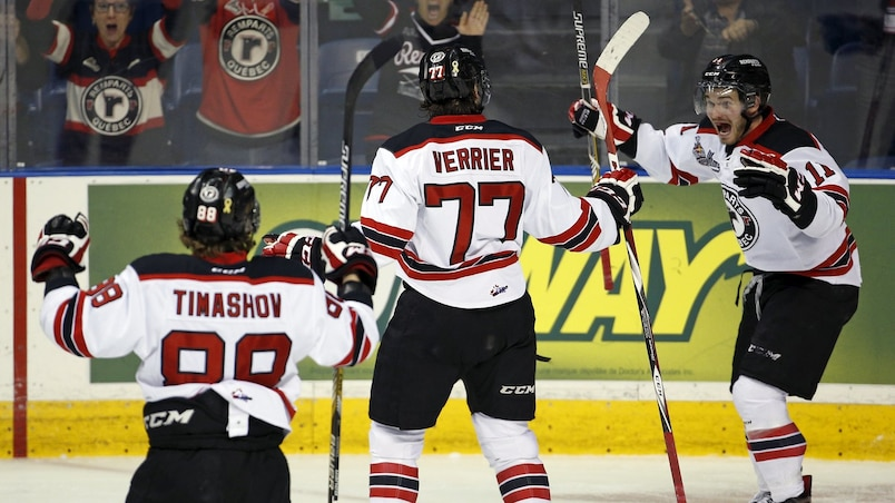 Quebec Remparts' Jerome Verrier is congratulated by his teammates Dmytro Timashov and Marc-Olivier Roy after he scored a goal against the Rimouski Oceanic during the first period of their Memorial Cup